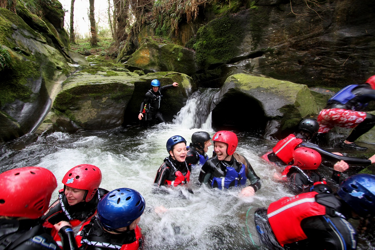 Gorge Scrambling group in water below flume, Isle of Man
