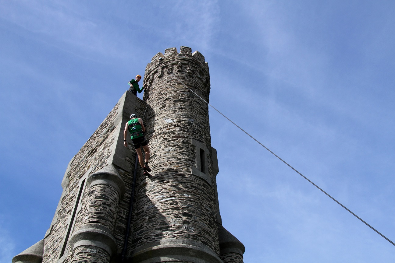 Competitor abseiling down Milners Tower during Adventure Race special stage, Isle of Man