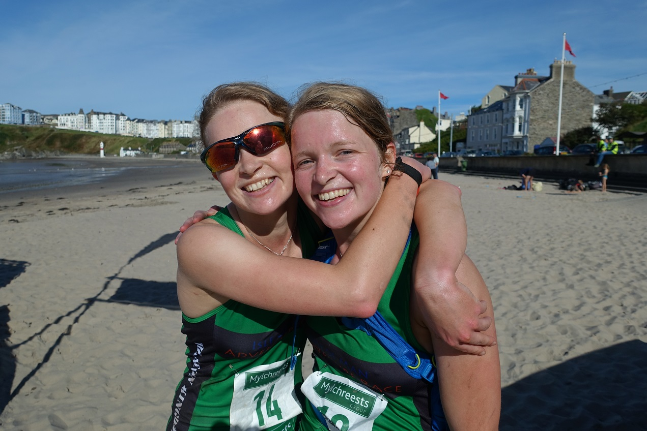 Competitors at the beach finish line, at the Seven Kingdoms Isle of Man Adventure Race