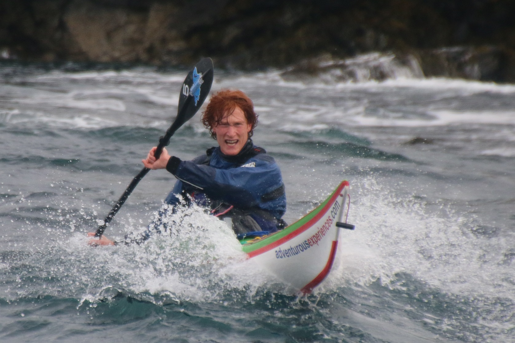 Surfing down a wave with ginger hair
