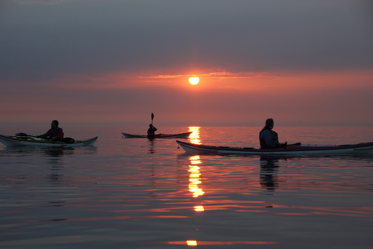 Sunset evening sea kayaking, Isle of Man