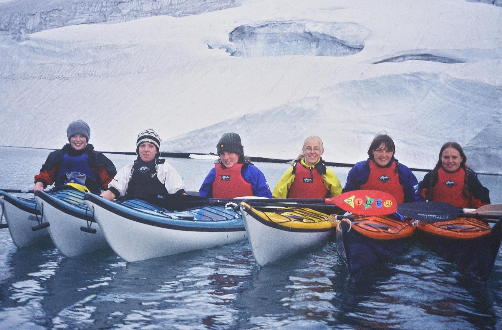 Youth group in sea kayaks on water in Norway 2003