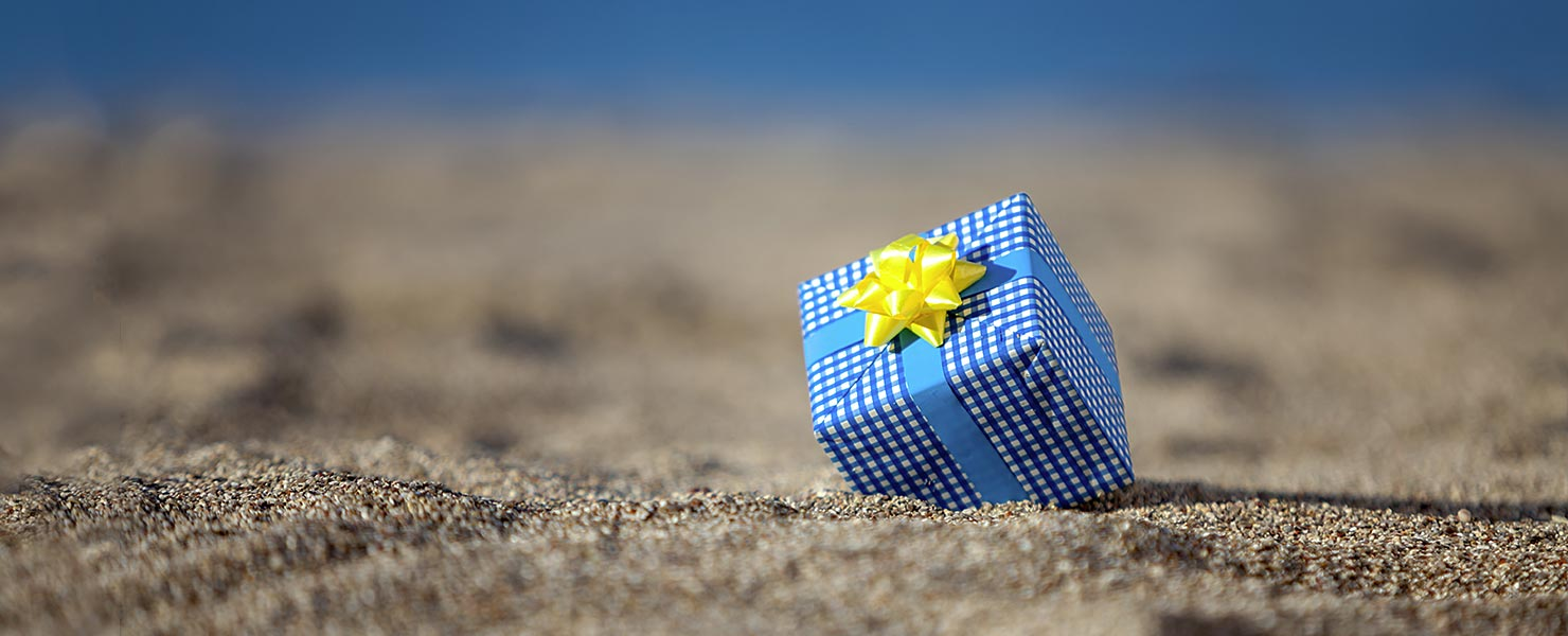 Gift box on beach, Isle of Man
